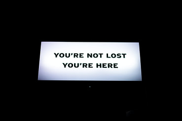 "Billboard with copy ""You're not lost you are here"""